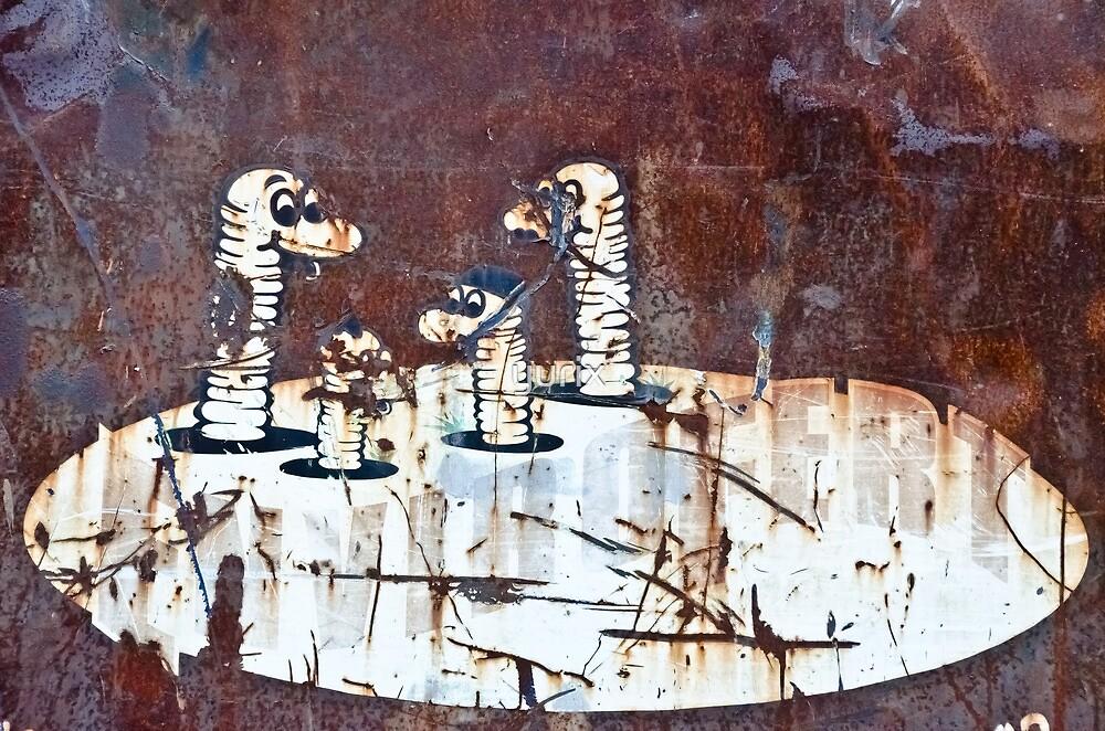 Worms Graffiti on the grunge rusty metal wall by yurix