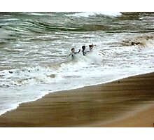 Fun in sand and water at Port Campbell Beach Photographic Print