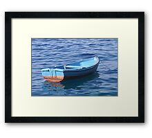 Small Boat Floating on Water Framed Print
