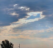 Sun Rays and Storm Clouds by Keala