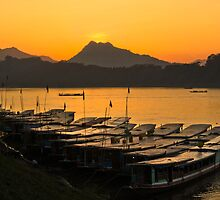Longboats on the Mekong at Sunset by MichaelDarn