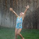 Playing in the sprinkler...... by DonnaMoore