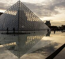 Paris - Louvre Pyramid Reflecting in the Fountain's Pool by Georgia Mizuleva