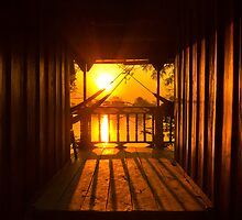 Sunset through bungalow by MichaelDarn