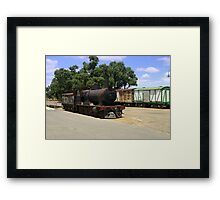 An abandoned locomotive & Carriages Framed Print