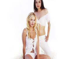 Mila Kunis and Elisha Cuthbert by HellFury