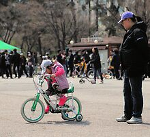 Mom Teaching Daughter to Ride a Bike by Christian Eccleston