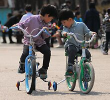 2 Brothers Learning to Ride Bikes by Christian Eccleston