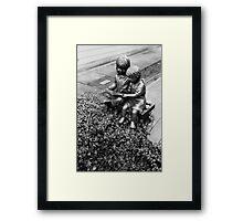 Reading in black and white Framed Print
