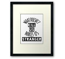 What Doesn't Kill Us Makes Us Stranger Framed Print