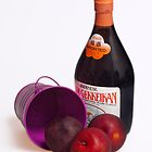 Purple bucket, plums and wine by Jay Gross
