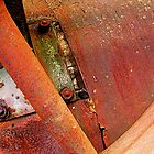 Rusted round by Mark Malinowski