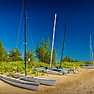 Catamaran Sailboats on the Beach by Randall Nyhof