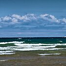 Clouds over a choppy Lake Michigan by Randall Nyhof