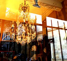 Reflections on a shop window with dolphin & chandelier by Christophe Claudel