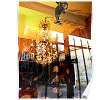 Reflections on a shop window with dolphin & chandelier Poster