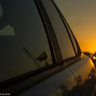 Driving Away From Sunsets by Moshe Levis