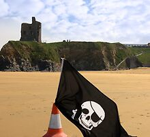 castle and beach with jolly roger flag by morrbyte