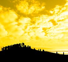 silhouette of a crowd on a hill by morrbyte