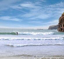 surfers near ballybunion cliffs by morrbyte