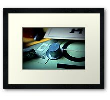 Monopoly board game being played on family game night Framed Print