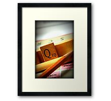 Scrabble board game being played on family game night Framed Print