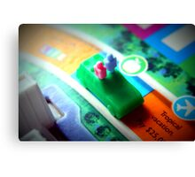 Life board game being played on family game night Canvas Print