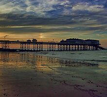 Cromer Pier at sunset by Avril Harris