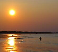 Boy Playing at Beach at Sunset by jemvistaprint