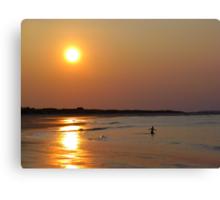 Boy Playing at Beach at Sunset Canvas Print