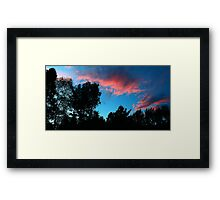 Redish Clouds Framed Print