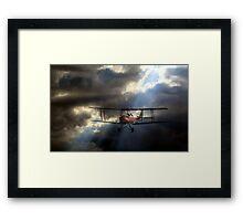 Tiger Moth in a stormy sky Framed Print