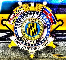 Sheriff Badge on a Police Car in Assateague, Maryland, USA by Noam  Kostucki