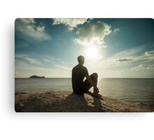 Man Watching Sunset by the Ocean Canvas Print