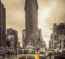 Flatiron building and NYC cab by Andrew-Thomas