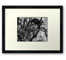 woman in garden II Framed Print