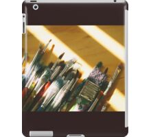 Art brushes on a wood table iPad Case/Skin