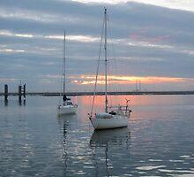 Sunset on Dublin Bay, Dun Laoghaire, Ireland by nilesite