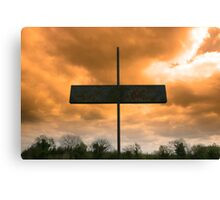 metal cross against a red stormy sky Canvas Print