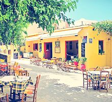 Open for dinner: bright yellow restaurant in Crete, Greece  by Susan Wellington