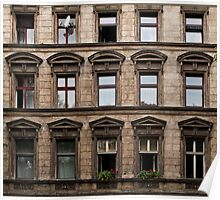 Facade of an old grey building in East Berlin Poster