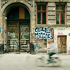 Bike riding through the streets of Berlin  by Reinvention
