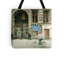 Bike riding through the streets of Berlin  Tote Bag