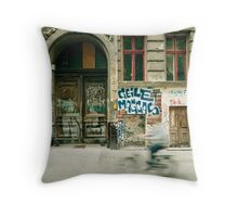 Bike riding through the streets of Berlin  Throw Pillow
