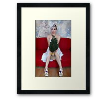 Young woman holding a small christmas tree Framed Print