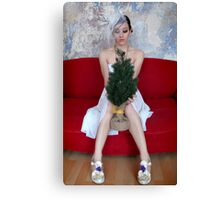 Young woman holding a small christmas tree Canvas Print