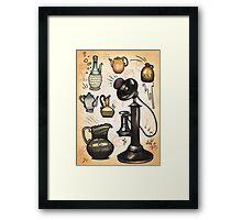 antique telephone, teapots and bottles Framed Print