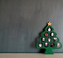 Lonely Wooden Christmas Tree on a dark grey background by Reinvention