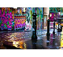 Bollards in a Rainy Graffiti Lane Photographic Print