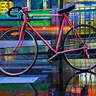 Bicycle on a Rainy Street by jamjarphotos